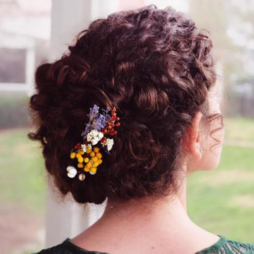 Curly Hair Updo With Flowers