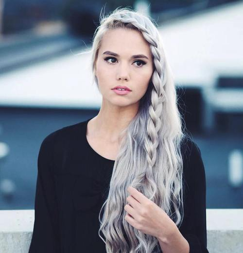 long side-swept hairstyle with a side braid