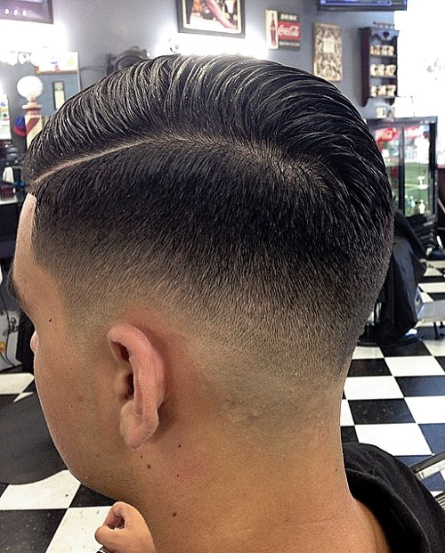 men's side part hairstyle with fade