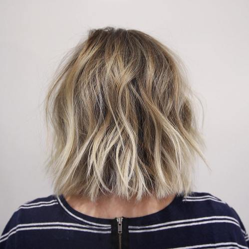 medium length straight cut messy bob with balayage