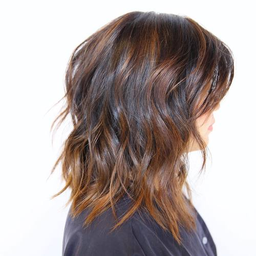medium brown hairstyle with balayage highlights