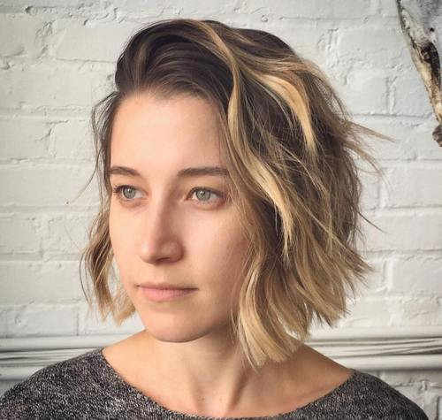 side-swept wavy bob with highlights