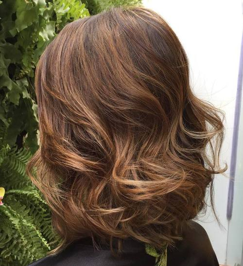 long curled brown bob with subtle highlights
