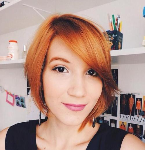 red asymmetrical bob with side bangs