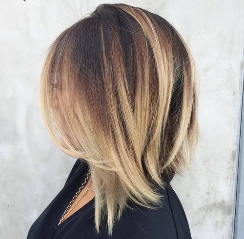 angled dark brown lob with blonde balayage