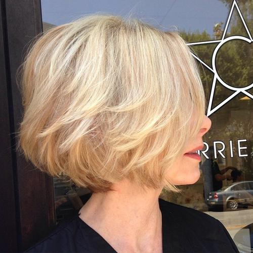 short wavy strawberry blonde bob