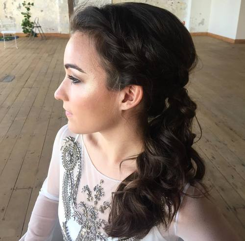 side curly ponytail with a loose braid
