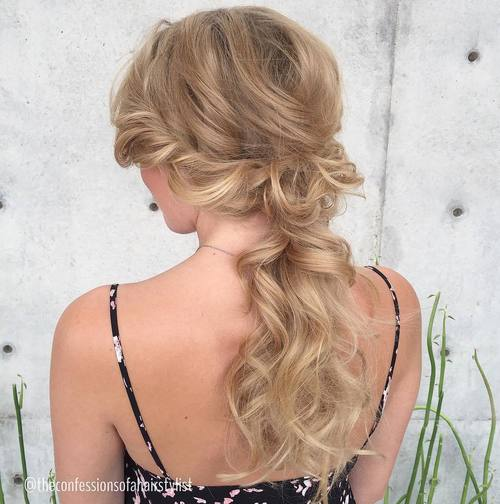 blonde wavy low ponytail with side twists