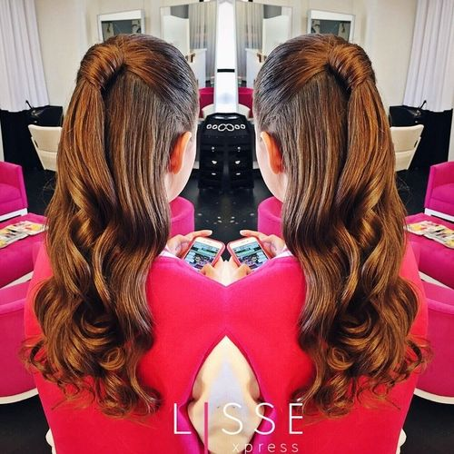 polished curly half ponytail