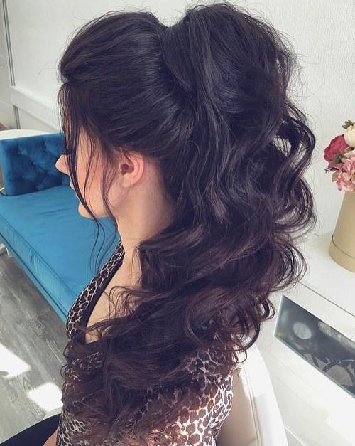 30 eye catching ways to style curly and wavy ponytails long curly ponytail with a bouffant pmusecretfo Image collections