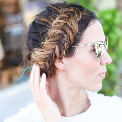 messy fishtail crown updo