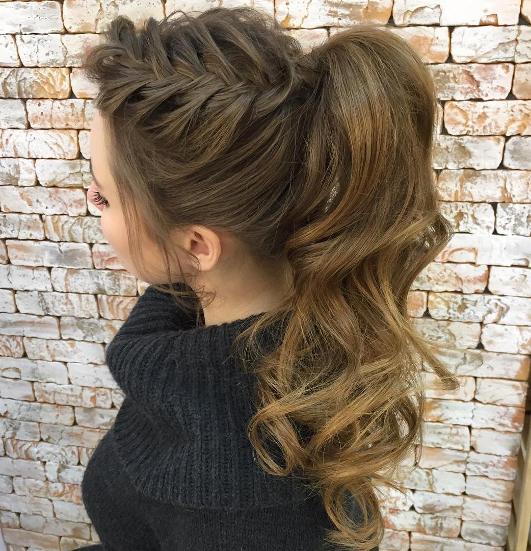 30 eye catching ways to style curly and wavy ponytails curly ponytail with a side braid pmusecretfo Image collections