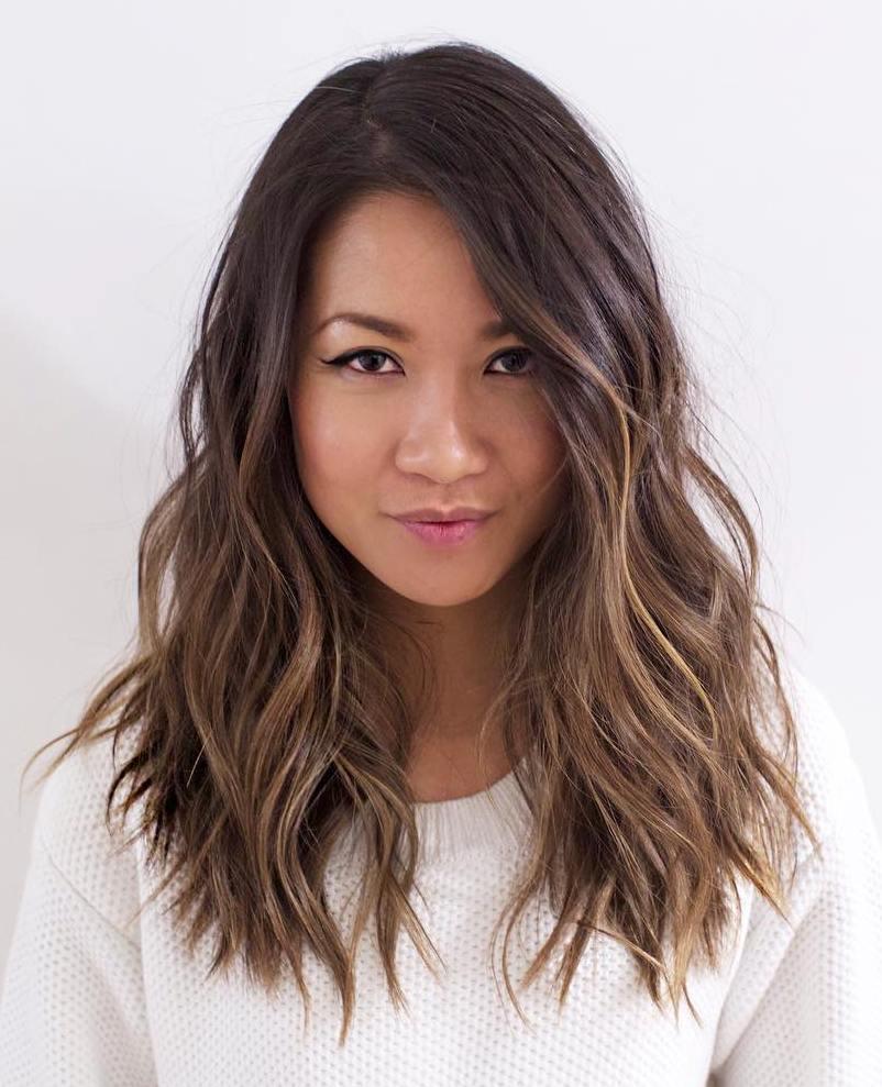 layered wavy brunette hairstyle