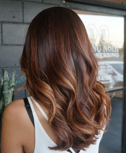 long dark brown hair with auburn balayage