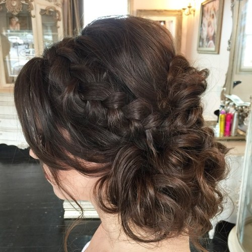 messy brunette updo with a braid for medium hair
