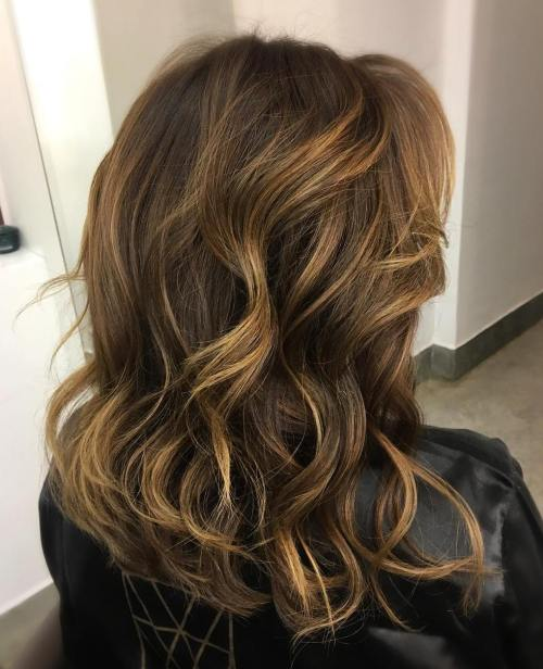 dark brown hair with light brown and blonde highlights