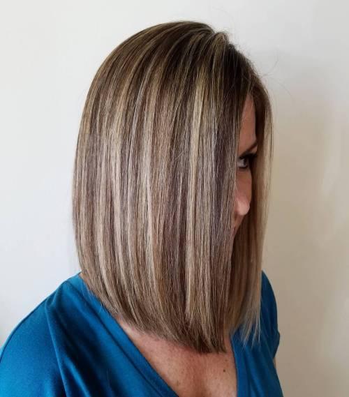 Dark brown hair with highlights around face