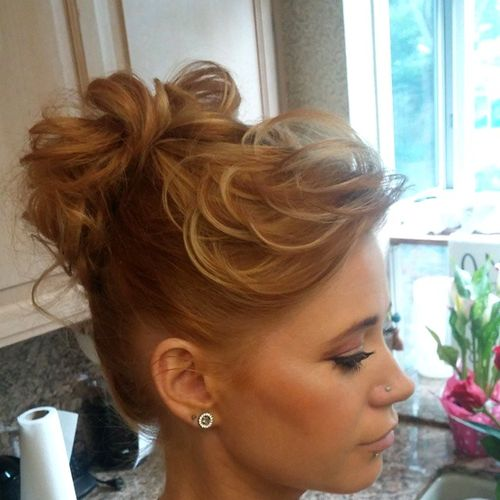 high curly bun with bangs for shorter hair