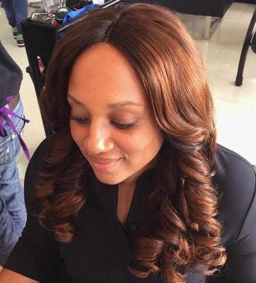 centre-parted brunette weave hairstyle