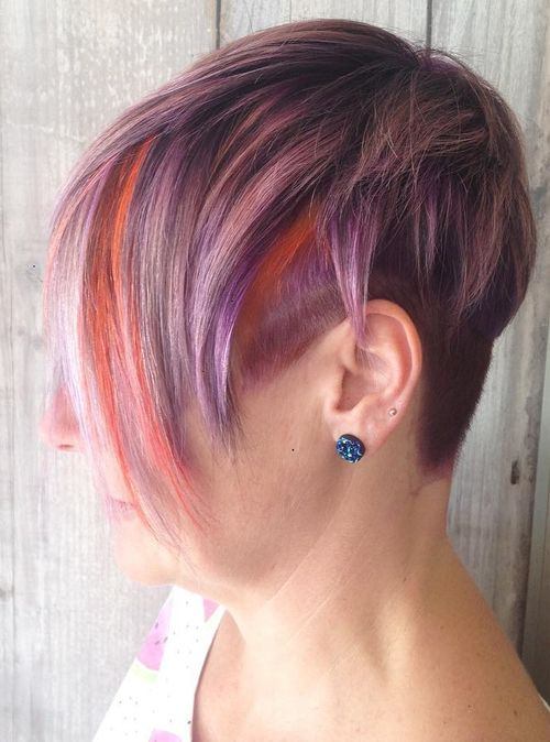 short pastel purple hair with orange peek-a-boo highlights