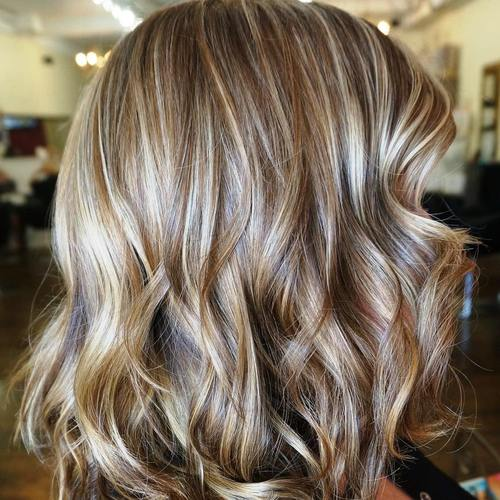 medium brown hairstyle with caramel and blonde highlights