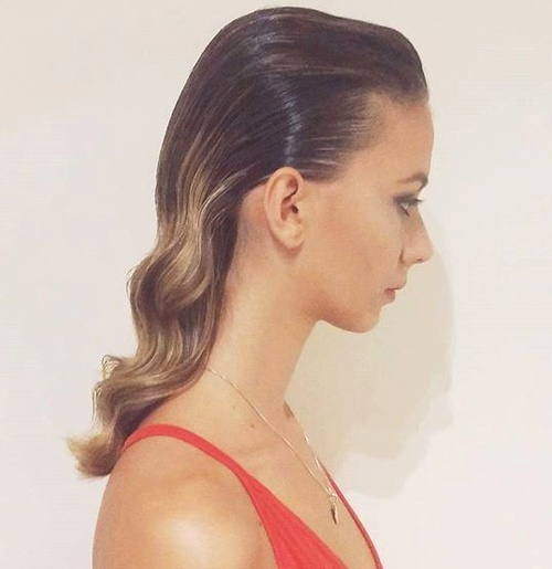 sleek wet look wavy downdo
