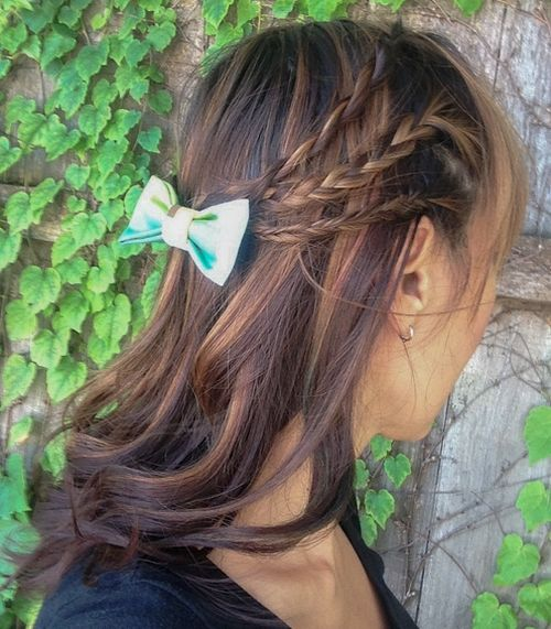 half up braided hairstyle with a bow