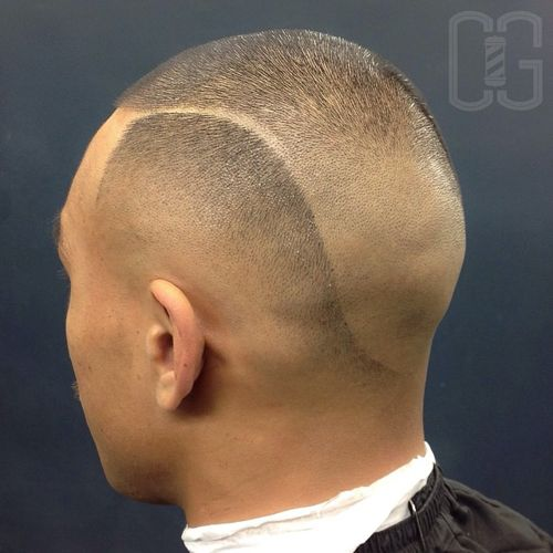 very short buzz cut with shaved lines and fade