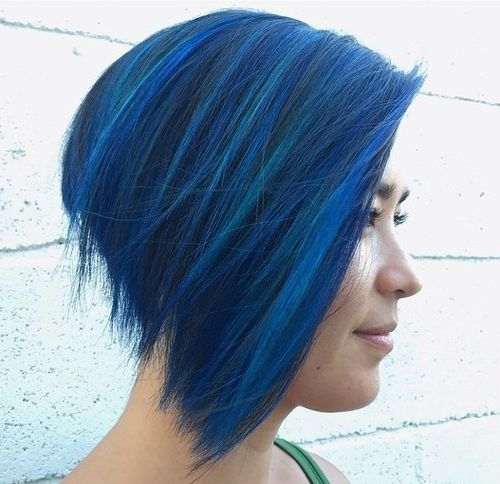 angled choppy bob with blue highlights