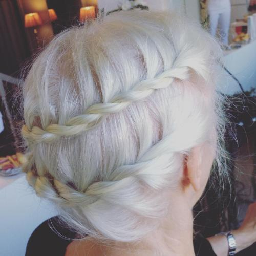 messy updo with two braids
