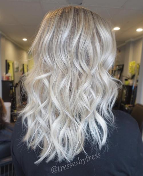 blonde curly hair with darkened roots