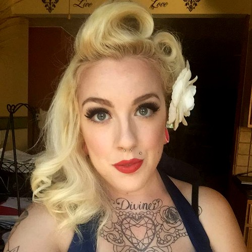 blonde asymmetrical victory rolls hairstyle