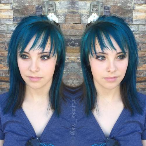 layered black hairstyle with blue highlights