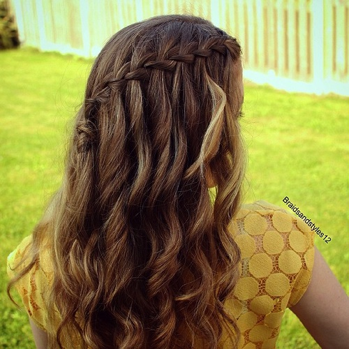 curly half up waterfall braid hairstyle