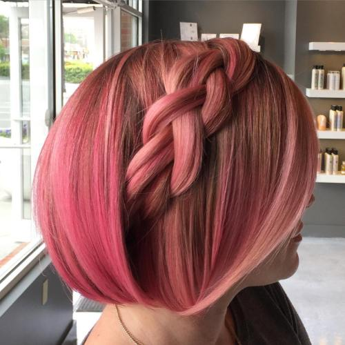 short pastel pink hairstyle with a braid