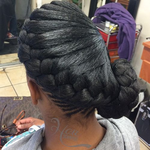 black asymmetrical side braided bun updo