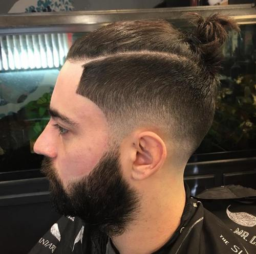 man bun with side fade hipster hairstyle