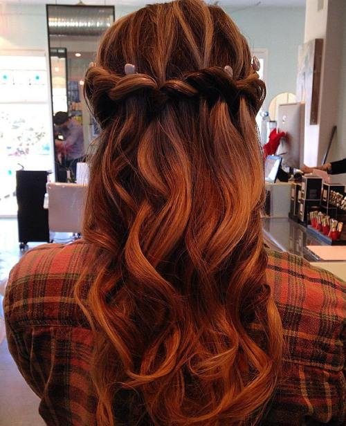 red curly half updo with waterfall braid