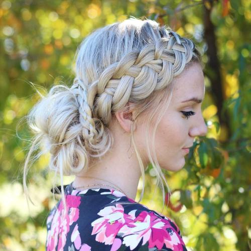 Low Messy Bun And Strand Side Braid