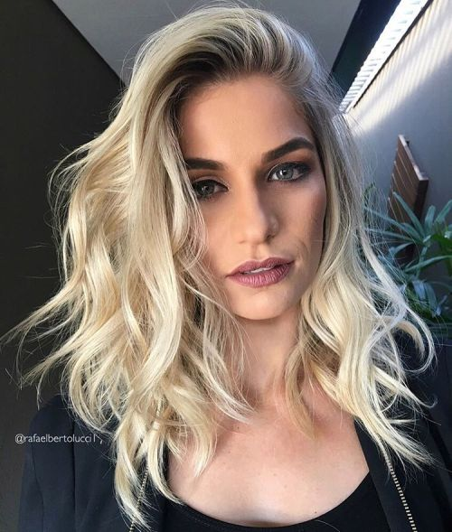 Mid-Length Tousled Blonde Hairstyle