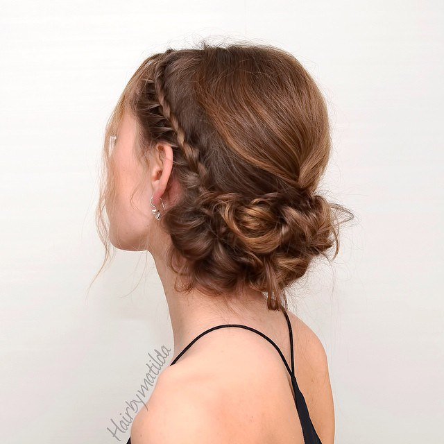 Low Curly Bun With A Braid