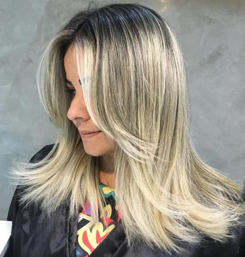 Mid-Length Cut With Face-Framing Layers