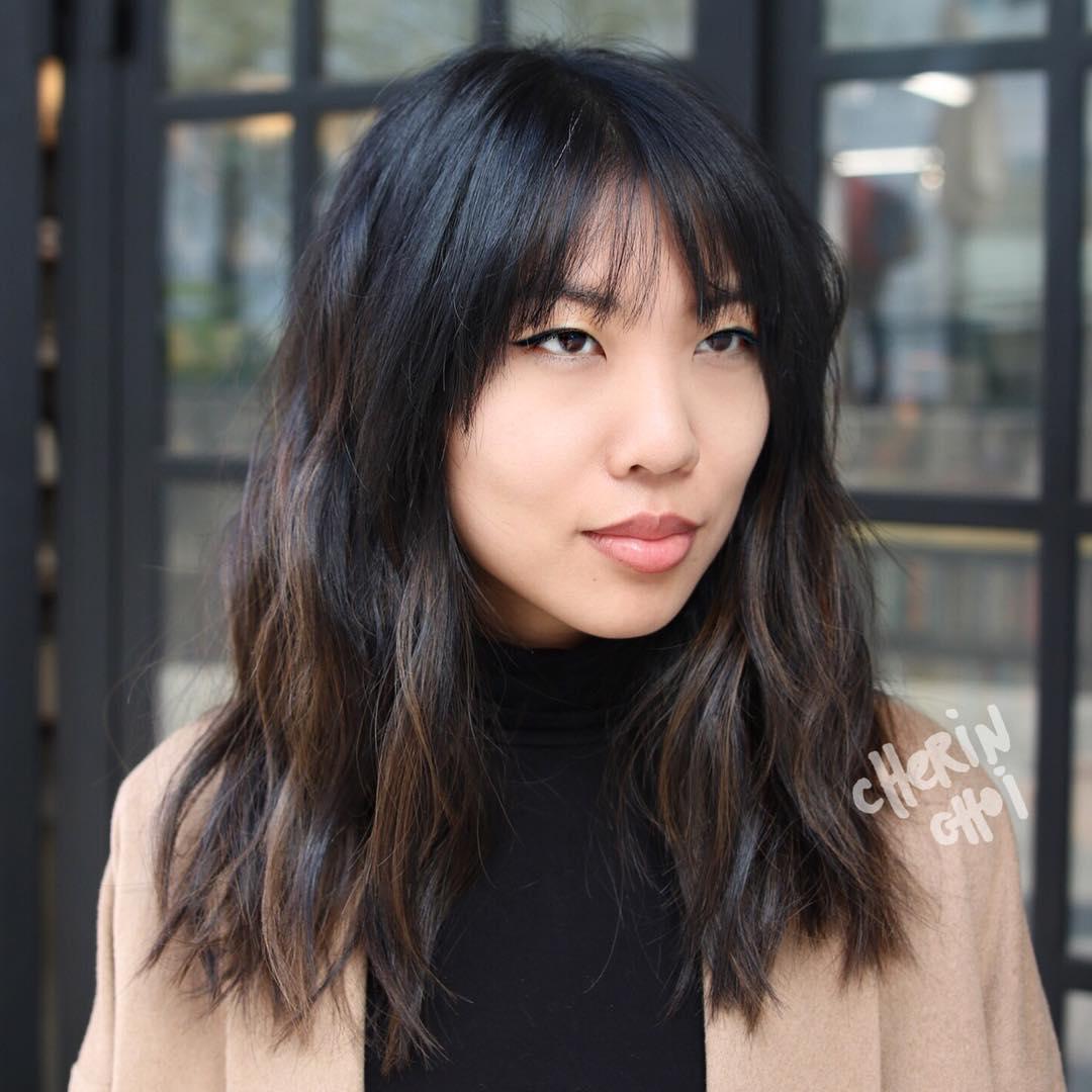 Medium Layered Asian Haircut With Bangs