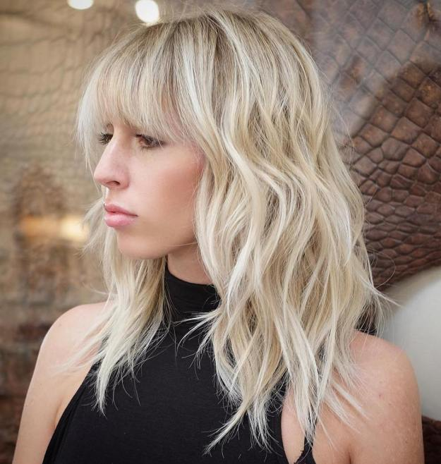 Blonde Layered Hairstyle With Bangs