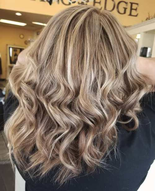 Ash Blonde Curls With Foil Highlights