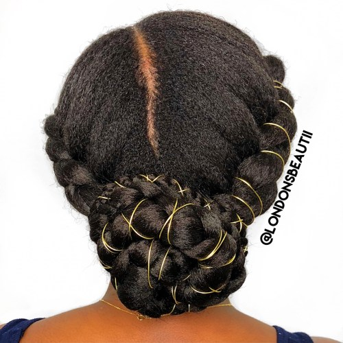 Low Braided Bun with Asymmetrical Part