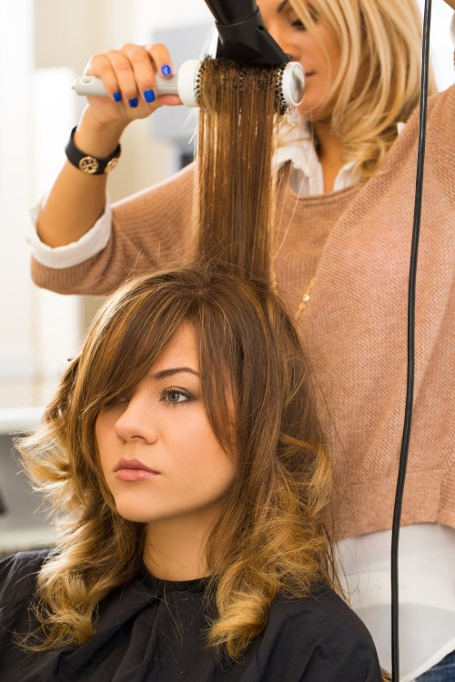 Woman Getting Her Hair Cut and Styled at a Salon
