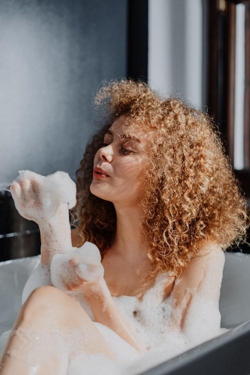 Woman with Coily Hair Taking a Bath