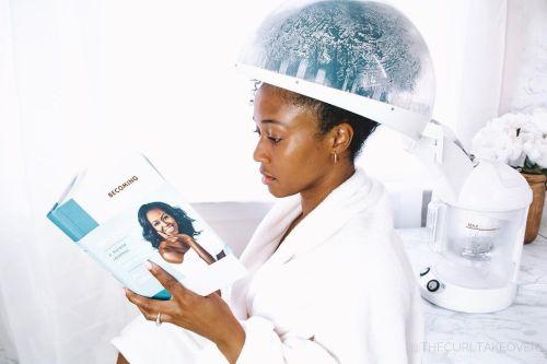Woman Using a Home Hair Steamer