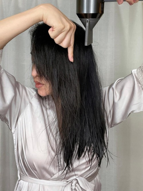 The Correct Way to Hold a Blow Dryer to Prevent Static Hair